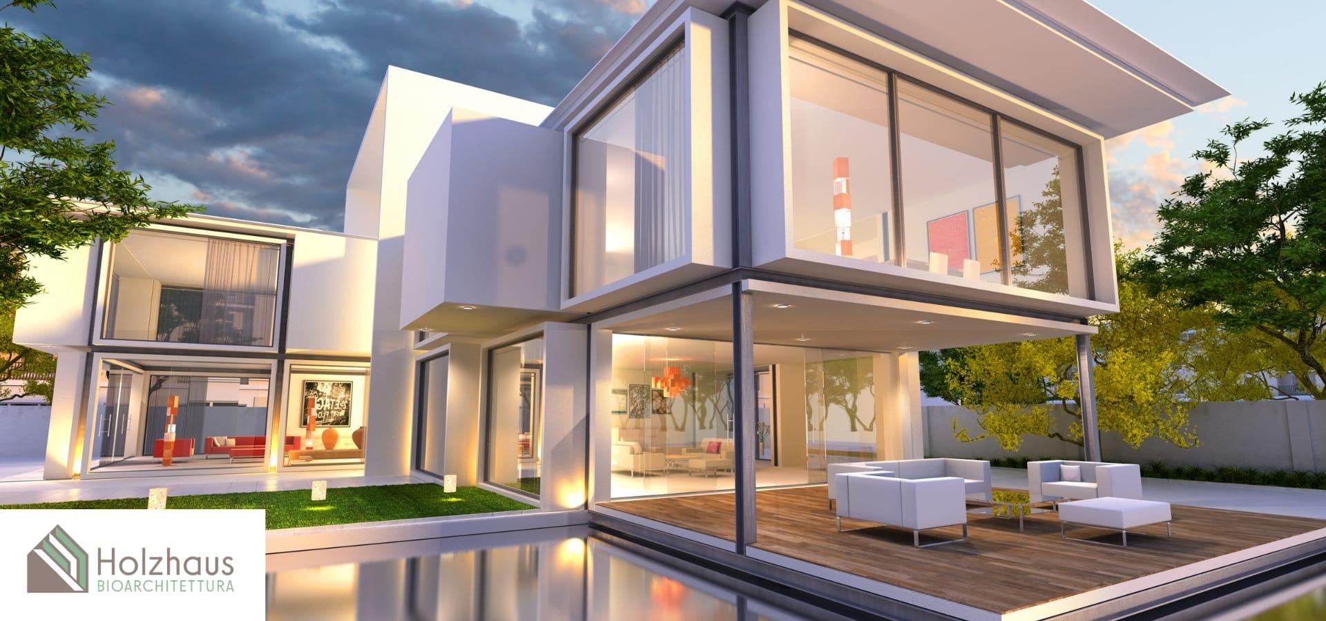 Soluzione moderna in legno a due piani con piscina esterna di Holzhaus Bioarchitettura