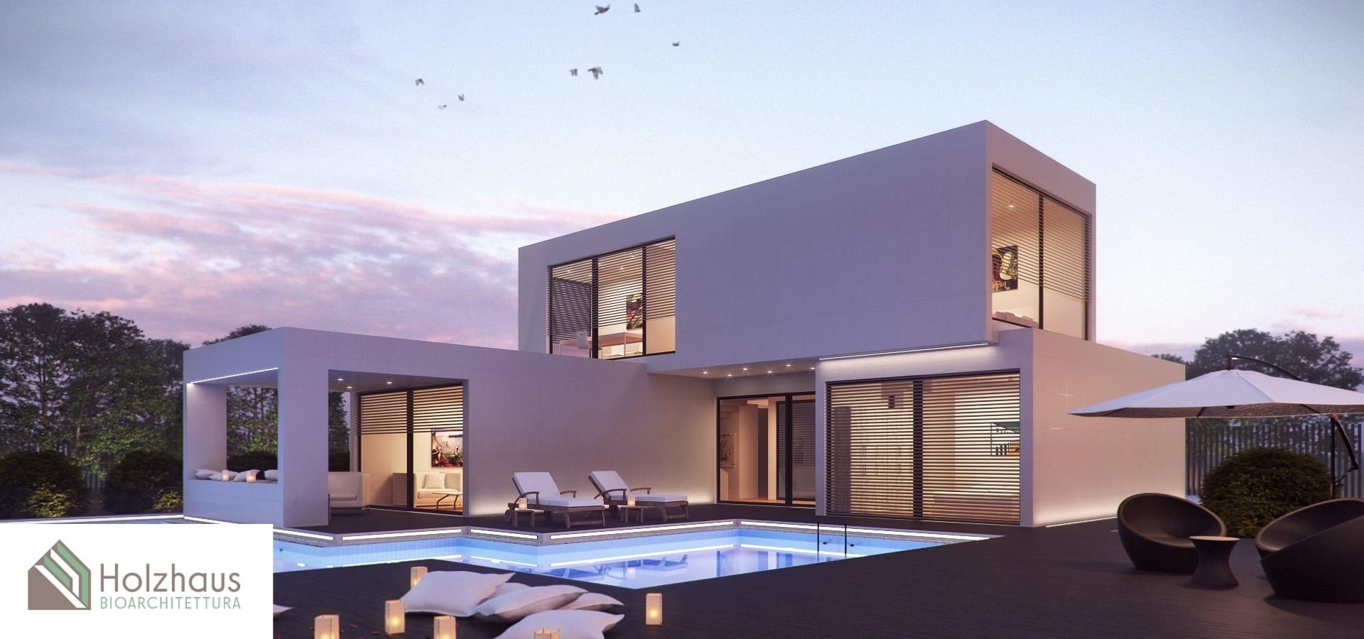 Esterno della soluzione moderna in legno a due piani con piscina esterna di Holzhaus Bioarchitettura