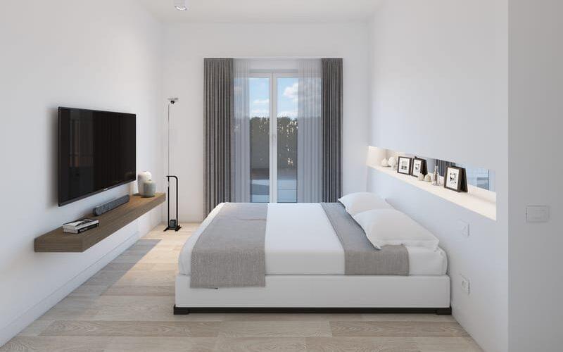 Camera da letto di una residenza costruita in legno a Vidigulfo